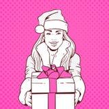 Bel usage Santa Costume Hold Gift Box de fille, Joyeux Noël et bruit Art Style de concept de bonne année rétro Image libre de droits