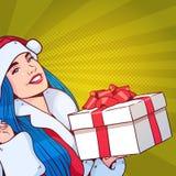 Bel usage Santa Costume Hold Gift Box de fille, Joyeux Noël et bruit Art Style de concept de bonne année rétro Image stock