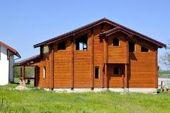 Bela dom, drewniana rama Obraz Royalty Free