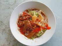 Belacan beehoon. Belacan Bee hoon which is essentially rice vermicelli served with cuttlefish fish with shrimp paste gravy.Popular among people in Kuching royalty free stock image