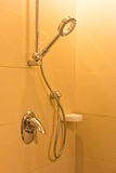 Belagd med tegel badrumdusch Arkivbild