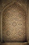 Belagd med tegel bakgrund med orientaliska prydnadar Royaltyfria Foton