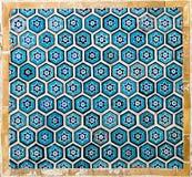 Belagd med tegel bakgrund med orientaliska prydnadar Fotografering för Bildbyråer