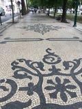 Belagd med tegel trottoar Royaltyfria Bilder