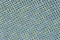 belagd med tegel vägg Arkivfoto