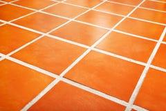 belagt med tegel keramiskt golv Arkivbilder