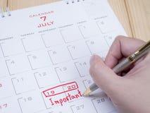 Belangrijke datum op kalenderbureau 10 Stock Foto's