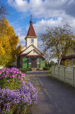 Belarus, Borisov: Old Belief orthodox Pokrovskaja Church. Indian summer. Sunny day. Ancient Old Belief orthodox church among flowers and the turned yellow trees Stock Photos