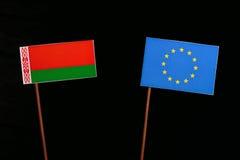 Belarus flag with European Union EU flag isolated on black. Background Stock Image