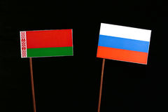 Belarus flag with Russian flag isolated on black. Background stock images