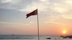 Belarus flag waving on ocean beach at sunset. Sri Lanka Stock Photo