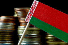 Belarus flag waving with stack of money coins Stock Photos