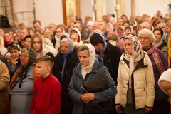 A crowd of people in the church. Belarus, Gomel, on April 8, 2018. The Nikolsky Monastery. The celebration of Orthodox Easter. A crowd of believers in the church royalty free stock photo