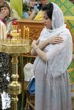 Pregnant woman in the church. Pregnant praying royalty free stock photo