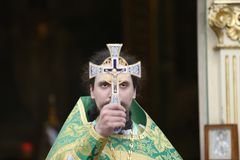 Priest with a cross stock images