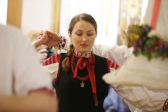 A woman in Belarusian clothes is dancing stock image