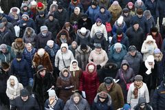 A large number of people shot from above stock photography