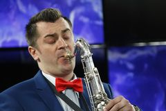 Musician with saxophone. Belarus, Gomel, the performance of the Gomel city orchestra. March 29, 2017.Playing the saxophone.Profession musician. Saxophonist Royalty Free Stock Images