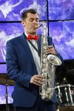 Musician with saxophone. Belarus, Gomel, the performance of the Gomel city orchestra. March 28, 2017.Playing the saxophone.Profession musician. Saxophonist Royalty Free Stock Images