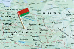 Belarus map flag pin. Closeup shot of Belarus map and flagpin stock photos