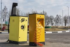 The compressor for pumping of tires and a vacuum cleaner Minsk,. Belarus, Minsk-April 10, 2018: Compressor for car tires pumping and vacuum cleaner at gas royalty free stock photos