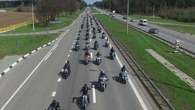 BELARUS, MINSK - April 23, 2016: Motorcycle Season opening parade with thousands of bikers on the road. Panoramic top view stock video footage