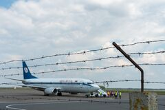 Belarus, Minsk, July 3, 2021: A plane on the territory of the airport against the background of barbed wire. Closed territory of a