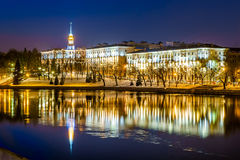 Belarus, Minsk, river Svisloch. Residential buildings in the style of Stalin's empire, evening reflection in the water Stock Photos