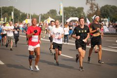 Belarus, Minsk, September 2018: athletes and fans of the Minsk half marathon finish Royalty Free Stock Photos
