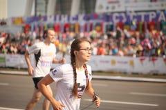 Belarus, Minsk, September 2018: athletes and fans of the Minsk half marathon finish. Belarus, Minsk, September 2018: athletes and fans of the Minsk half marathon Royalty Free Stock Photos