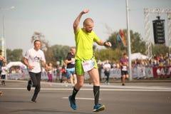 Belarus, Minsk, September 2018: athletes and fans of the Minsk half marathon finish. Belarus, Minsk, September 2018: athletes and fans of the Minsk half marathon Stock Image