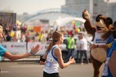 Belarus, Minsk, September 2018: athletes and fans of the Minsk half marathon finish. Belarus, Minsk, September 2018: athletes and fans of the Minsk half marathon Stock Photography