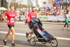 Belarus, Minsk, September 2018: athletes and fans of the Minsk half marathon finish. Belarus, Minsk, September 2018: athletes and fans of the Minsk half marathon Royalty Free Stock Photo