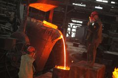 Belarus, Minsk, 2014. Work in the foundry. molten metal worker at a metallurgical plant stock photos