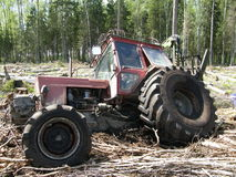Belarus Mtz 82 forestry tractor stuck in deep mud Royalty Free Stock Photos