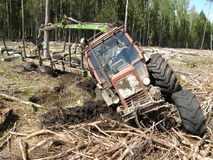 Belarus Mtz 82 forestry tractor stuck in deep mud Stock Images