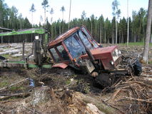 Belarus Mtz 82 forestry tractor stuck in deep mud Royalty Free Stock Photo