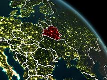 Belarus in red at night. Belarus from orbit of planet Earth at night with visible borderlines and city lights. 3D illustration. Elements of this image furnished Royalty Free Stock Image