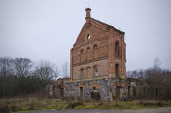 Belarus: ruins of ancient distillery. Ruins of ancient distillery in the village of Shemetovo. Fall of a thicket of a grass and bush. Cloudy weather stock images