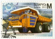 BELARUS - 2015: shows BelAZ 75710, world`s largest, highest payload capacity haul truck, series Machine Building of Belarus. BELARUS - CIRCA 2015: A stamp Stock Images