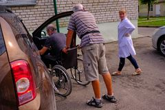 Man in a wheelchair at the emergency room of the city hospital royalty free stock photography