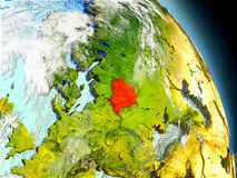 Belarus from space. Belarus in red on model of planet Earth with embossed countries and visible country borders. 3D illustration with clouds and reflective ocean Stock Image
