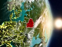 Belarus during sunrise. Highlighted in red on planet Earth with visible country borders. 3D illustration. Elements of this image furnished by NASA Stock Photo