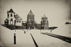 The Mir Castle. winter. Belarusian attraction Mir Castle covered with snow in the winter season. retro style stock photo