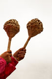 Belarusian braided musical instrument. Girl's hands holding a wicker rattles Royalty Free Stock Image
