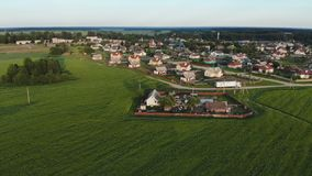 Belarusian village. Aerial view at sunset in the evening. stock footage