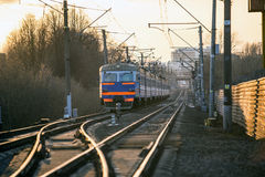 Belarussian train. And rails at twilight with selective focus Royalty Free Stock Images