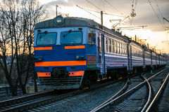 Belarussian train. And rails at twilight with selective focus Stock Photos