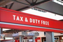 Belasting en belastingvrij embleemteken Stock Foto's
