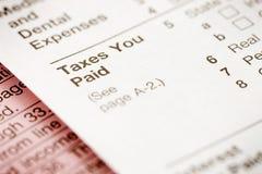Belastingen: De nadruk op Belastingen u betaalde Sectie Stock Afbeelding